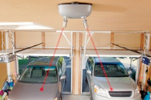 Image courtesy of SmartHome.  The central laser broadcast station is positioned in the middle, between 2 car parking locations.  When you click your garage door opener, the laser activates.  The laser light has been pre-directed to a specific location on your dashboard, so that as you advance into your garage, the light harmlessly runs over your hood and on to the designated location, which you know is the proper spot at which to stop your vehicle.  Only well-informed garage architects know about such economical and highly functional features for your garage.