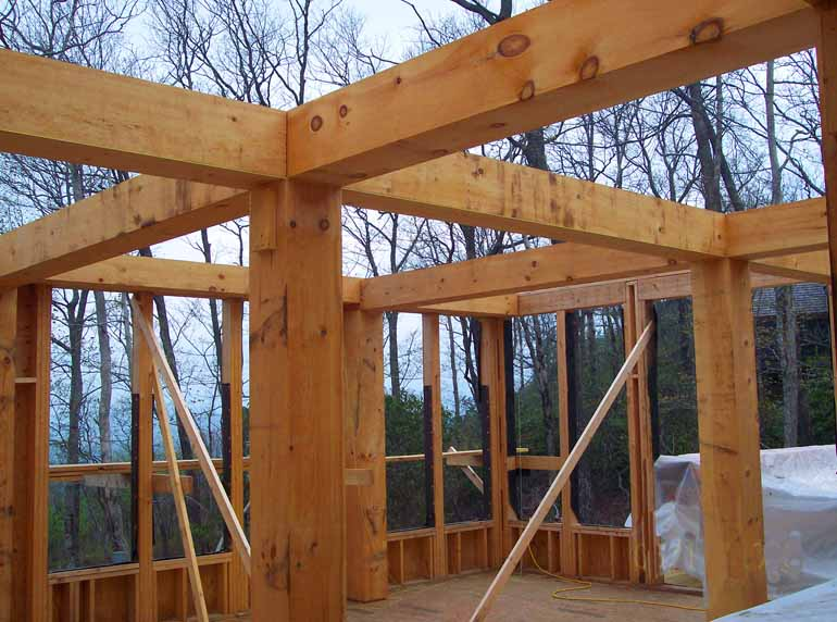 Post and beam mountain home architects timber frame for Post beam house