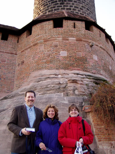 Rand, Merry and German relatives outside of a castle in Nuernberg. The rough stonework is reminiscent of present-day Rand Soellner Architect mountain masonry, where we use boulders in the rock work.