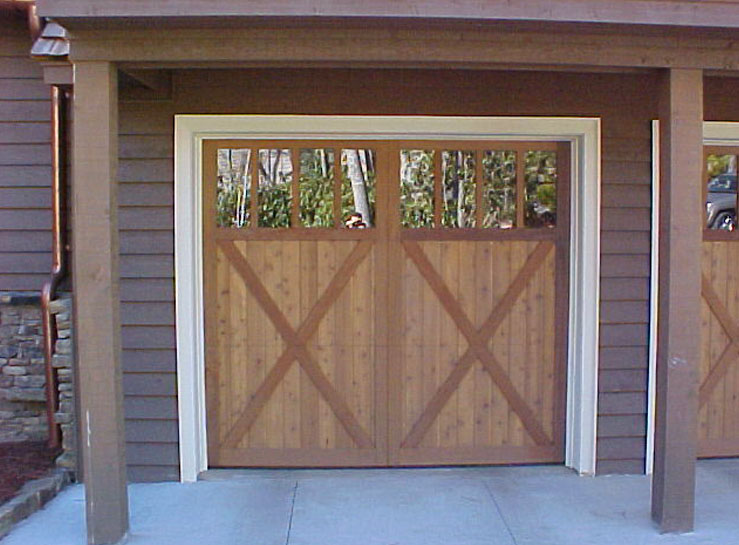Another example of Rand Soellner Architect's decorative treatments to garage doors.  All of Soellner's garage doors are motorized and are operated from your vehicle's remote control button, and roll upward to the garage ceiling.  The appearance that these doors are side hinged from a previous historic era are simply the result of the architect's design.