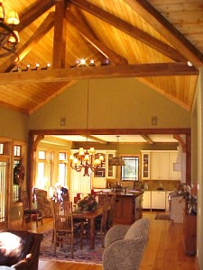 One of Rand Soellner's mountain home projects, this is a view from the Hearth Room through the Dining and into the open plan kitchen.  Interior designs for the mountains or anywhere else can benefit from this company's special touch.
