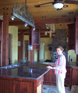 Here you can see Merry Soellner supervising the installation of the granite slabs she selected for this luxury home design project, under construction.