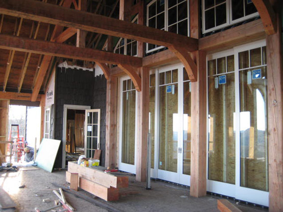 Some of the home architecture of Rand Soellner Architect.  This construction photo shows Soellner's trademarked Grand Canyon-Dor on one of his estate projects.  This sliding door is 12' tall x 22' wide and pockets invisibly on the sides, to allow the interior space seamlessly merge with the outside space. (C)Copyright 2007-2010 Rand Soellner, All Rights Reserved Worldwide.