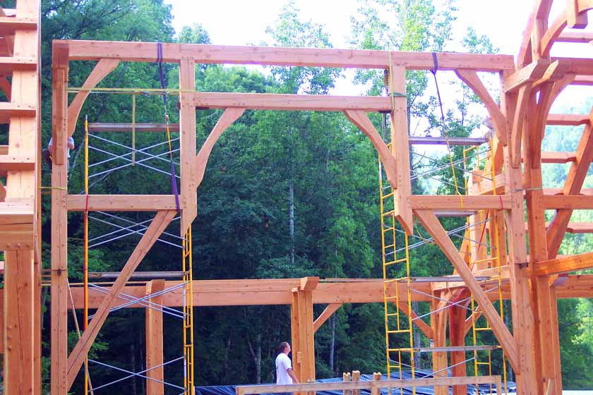 Timber frame home hammer trusses spanning long distances.  Castle home designed by Rand Soellner Architects, (C)Copyright 2005-2010, All Rights Reserved Worldwide.  Timber frame photo, fabrication & erection by Jeff Johnson Timber Frame inc.